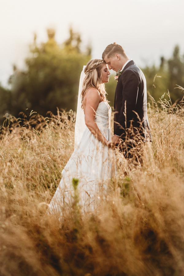 Bride and Groom Meadow Kiss